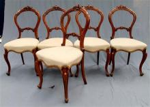 Five matching balloon back chairs with cabriole legs