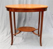 A 1920s maple oval two tiered occasional table