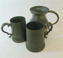 A pair of antique pewter one pint tankards, together with a one quart pewter tankard
