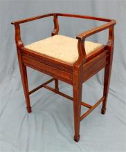 A 1920s Sheraton style revival piano stool with lift up seat