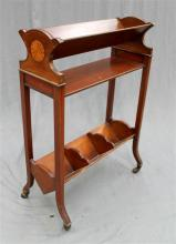 A small Bachelor's library book case on original casters