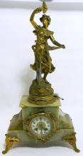 A figural gilt metal & onyx mantle clock