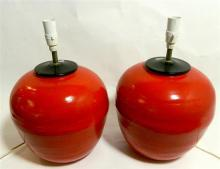 A pair of red painted timber lamp bases