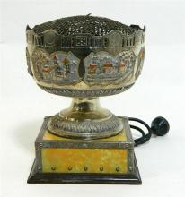 A mounted Middle Eastern silver rose bowl converted to a lamp