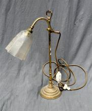 A brass desk lamp with an acid etched shade