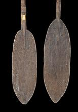 Two Old Mimika Paddles,