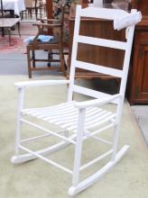 A white timber rocking chair,