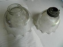 A pair of glass lightshades and bag of crystal drops