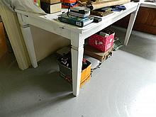 A white painted timber kitchen table