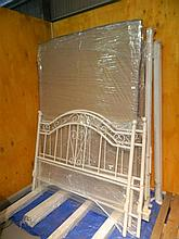 A pair of as new white metal double bed frames