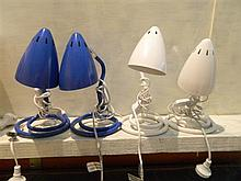 Two pairs of blue and white bedside lamps