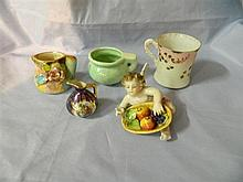 Five assorted ceramic items including cupid and jugs