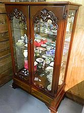 A reproduction two glazed door display cabinet