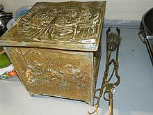 A brass decorated wood box and a set of three brass fire tools