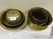 An assortment of brass bowls