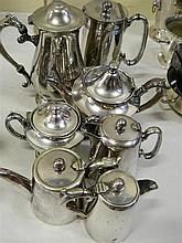 A collection of silver plate coffee, tea and chocolate pots