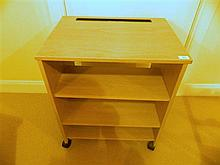 A mobile bookcase in limewash finish