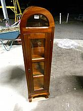 A teak dome topped single door display cabinet