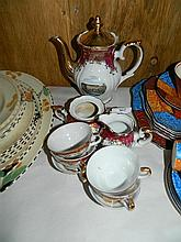 An Italian nine piece coffee set