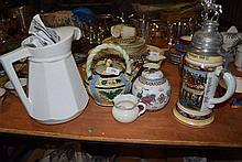 A large German beer stein, jug, teapot, ginger pot etc
