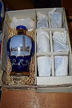 An Italian hand decorated decanter and glass set, unused