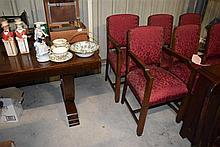 A art deco dining suite including four dining chairs and two carvers, table 152 x 90 cm