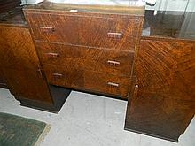 An art deco style sideboard three drawers, surmounted by two cupboard doors, rosewood veneer 152 x 53 x 98