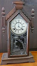 An Ansonia mantle clock in oak case
