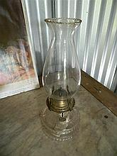 A small glass kerosene lamp