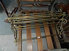 A pair of brass wall mounted luggage racks