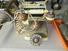 A reproduction Bakelite and brass telephone handset