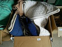 A box of assorted saddle cloths