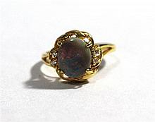 An 18ct Gold Black Opal and Diamond Ring