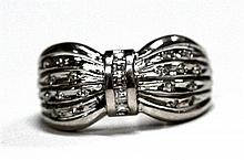 A Platinum and Diamond Bow shaped Ring