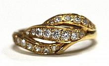 An 18ct Yellow Gold Diamond Twist style Ring