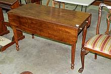 A 19th Century mahogany dropside table, over four turned and fluted legs, 117cm L