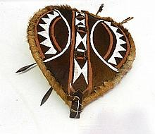 An Ibex Hide and Leather Masai Shield with Spear Darts