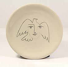 Picasso, P. (1881-1973). (A woman's face and a dove). Porcelain plate w. linear drawing, ±1965, Ø 24
