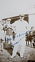 A signed photograph of Dan Bradman taken on the