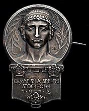 A Stockholm 1912 Olympic Games participation lapel badge,  silvered met