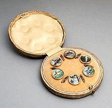 A cased set of six Edwardian gentlemen's sporting waistcoat buttons,  e