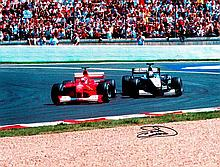 David Coulthard signed 2000 French GP poster-size colour photographic print