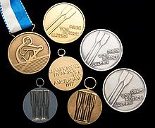 A group of seven rowing medals for World Championships and international re