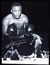 A signed b&w; Joe Frazier photo print,  16 by 12in., signature in silver