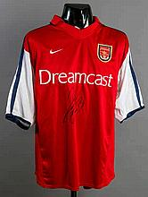 Giovanni van Bronckhorst: a signed red & white Arsenal No.16 Champions Leag