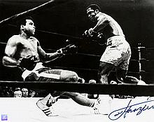 A Joe Frazier signed b&w; photograph,  a 16 by 20in, portraying Frazier