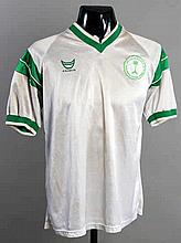 A white Saudi Arabia No.16 international jersey from the final tie of the 1