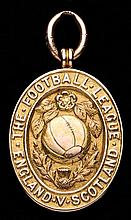 A 15ct. gold Football League representative medal awarding to Sam Greenhalg