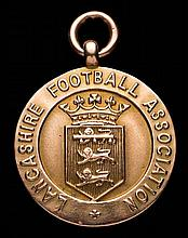 A 9ct. gold Lancashire Football Association Junior Cup winner's medal award