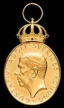 An official gold 1958 World Cup Merit Medal,  the head of King Gustaf V